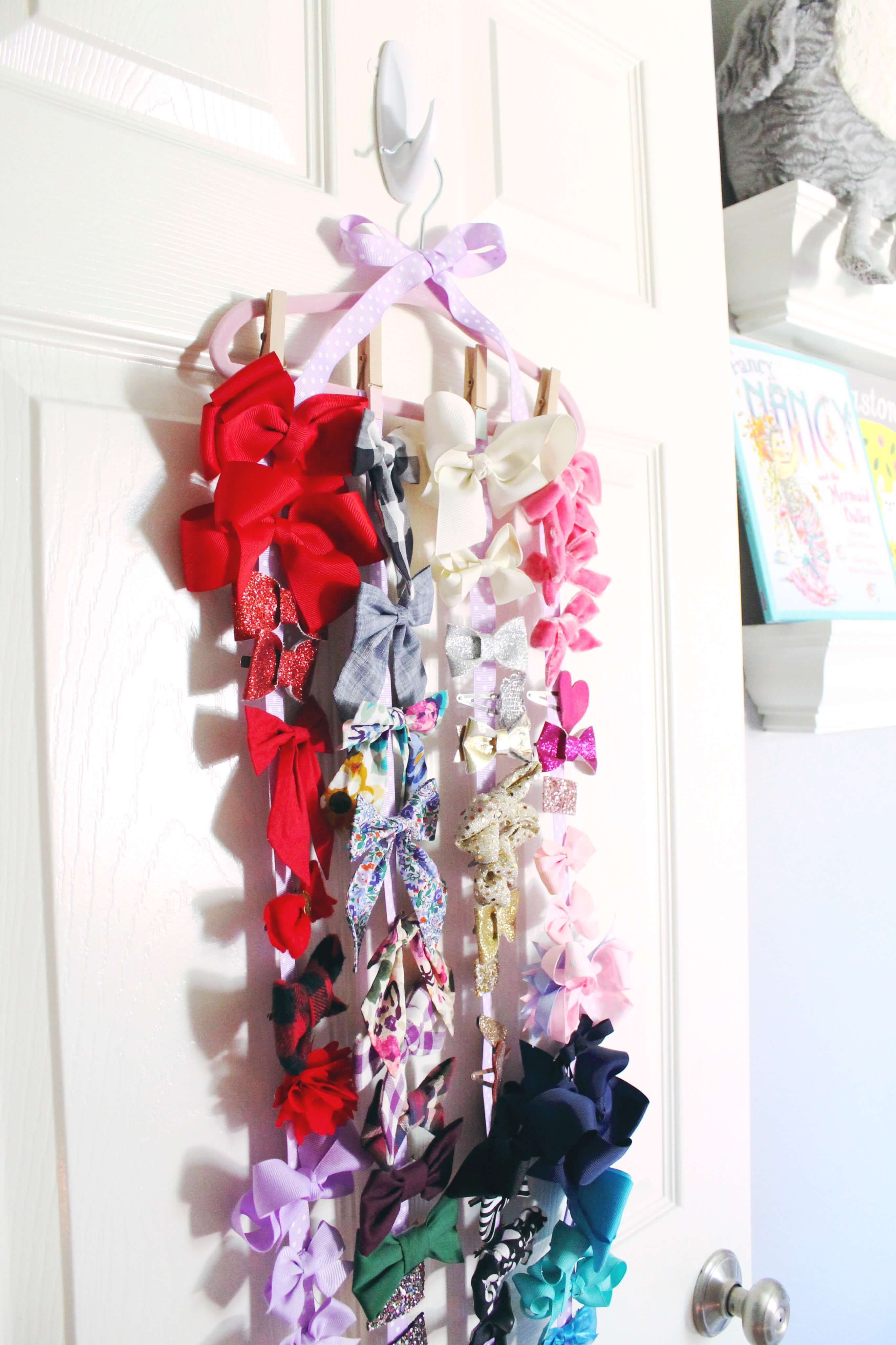The easiest DIY bow organizer to house all of your little girl's bow clips! You don't even need a hot glue gun for this DIY. So easy and cute!