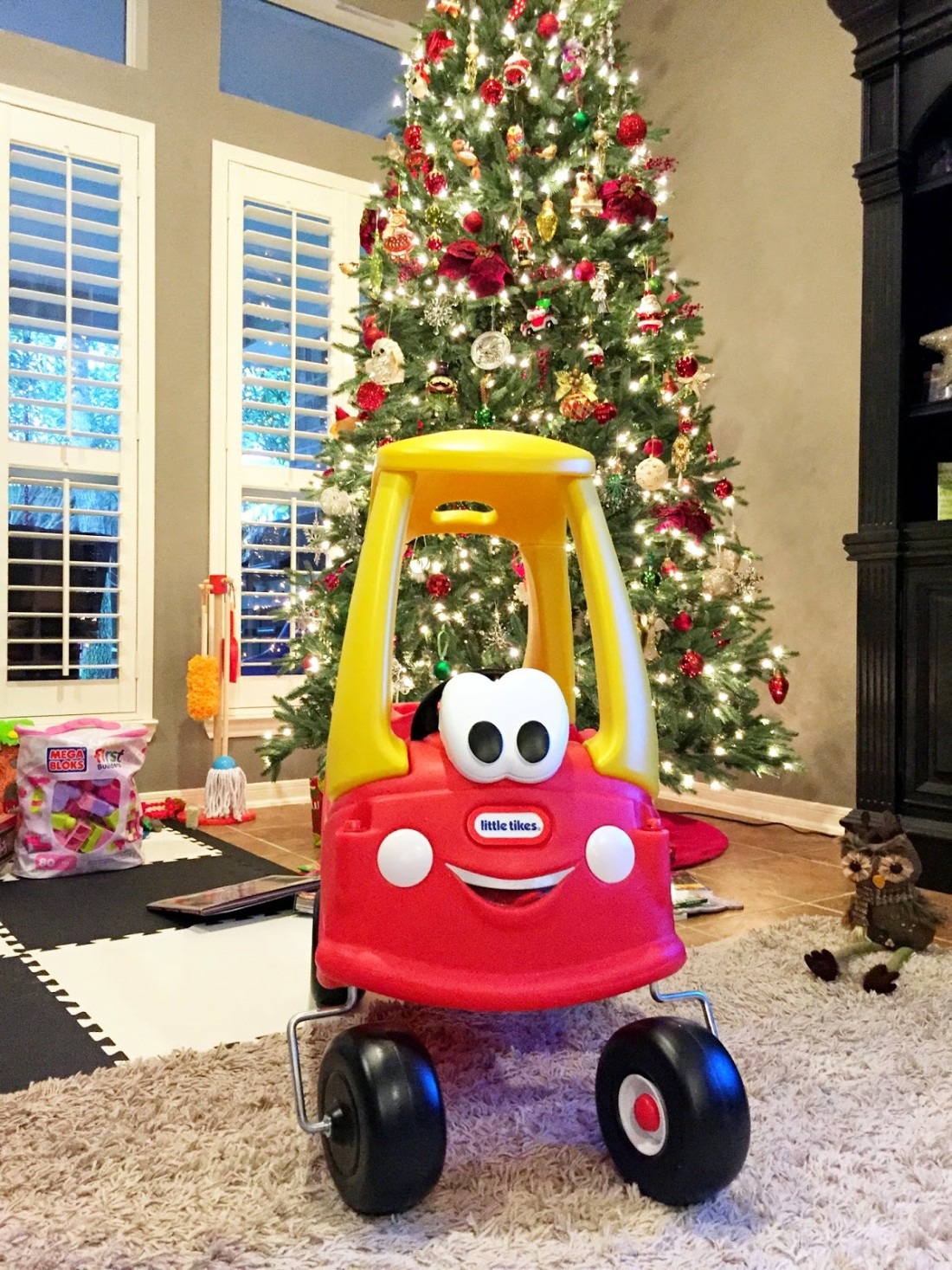 once we got home santa had left behind her big gift since it didnt fit on his sleigh she is in love with this thing